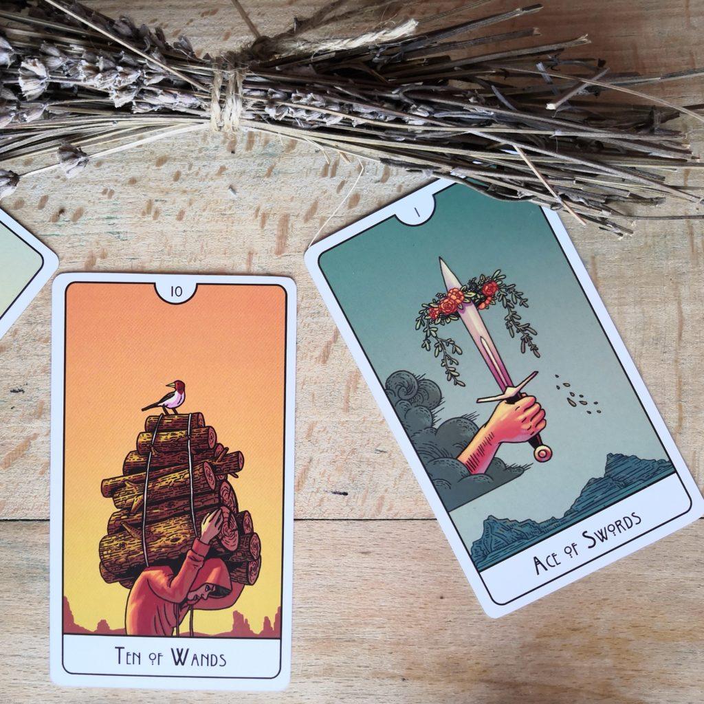 ten of wands + Ace of swords cards This might hurt tarot